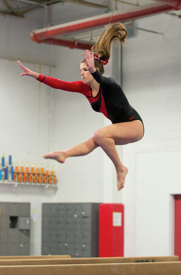 Warde's Tori Gallati competes on the beam during the gymnastic meet against Ludlowe High School at Gymnastics & Cheer Academy in Fairfield on Monday, Jan. 20, 2014. Photo: Amy Mortensen / Connecticut Post Freelance