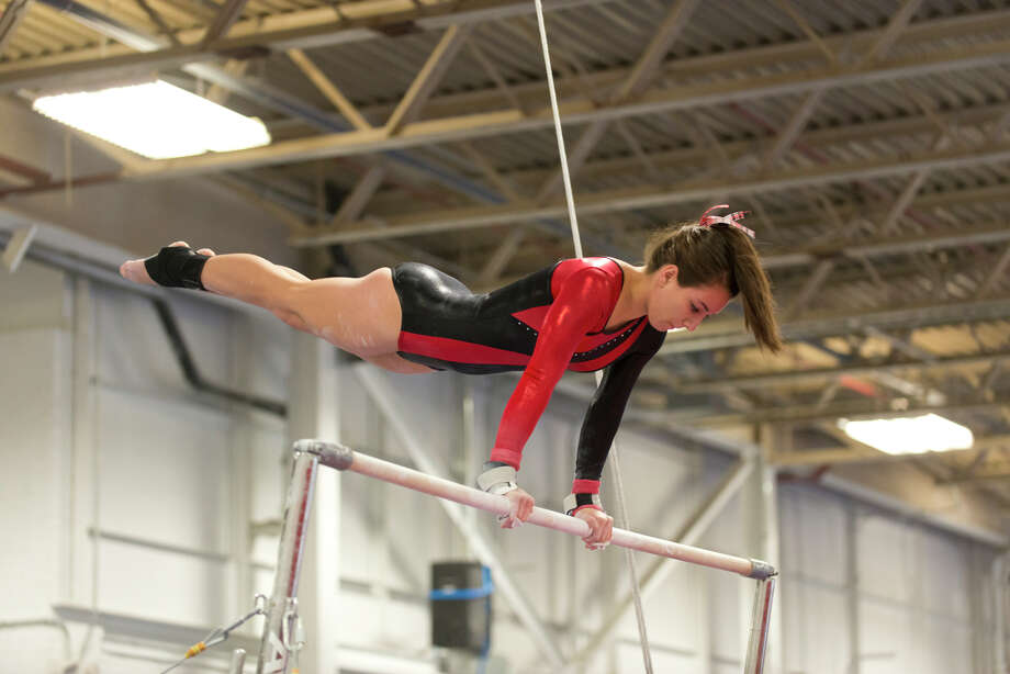 Warde's Veronica Bennett competes on the uneven bars during the gymnastic meet against Ludlowe High School at Gymnastics & Cheer Academy in Fairfield on Monday, Jan. 20, 2014. Photo: Amy Mortensen / Connecticut Post Freelance