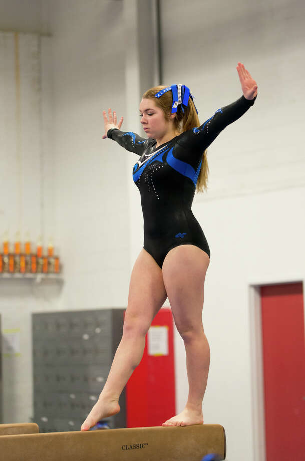 Ludlowe's Jordan Fenney competes on the beam during the gymnastic meet against Warde High School at Gymnastics & Cheer Academy in Fairfield on Monday, Jan. 20, 2014. Photo: Amy Mortensen / Connecticut Post Freelance
