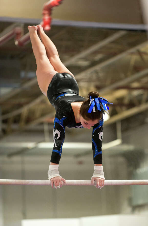 Ludlowe's Nicole Huntsman competes on the uneven bars during the gymnastic meet against Warde High School at Gymnastics & Cheer Academy in Fairfield on Monday, Jan. 20, 2014. Photo: Amy Mortensen / Connecticut Post Freelance