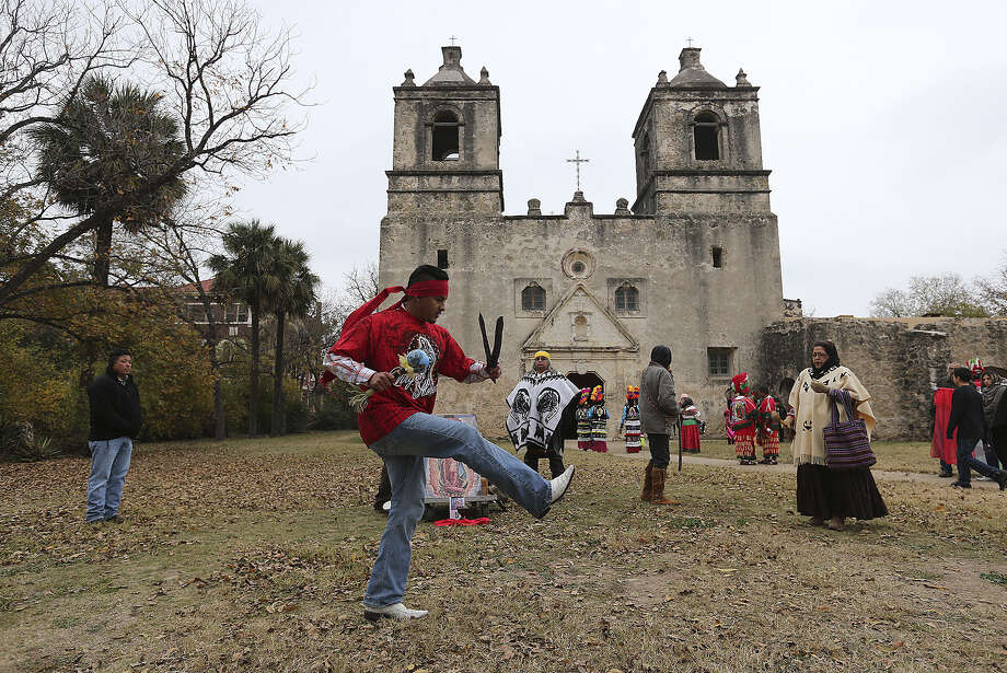Jesus Figueroa performs during La Danza de Matachines at Mission Concepcion in December. San Antonio is seeking to gain world heritage status for the missions. Photo: Jerry Lara / San Antonio Express-News / ©2013 San Antonio Express-News