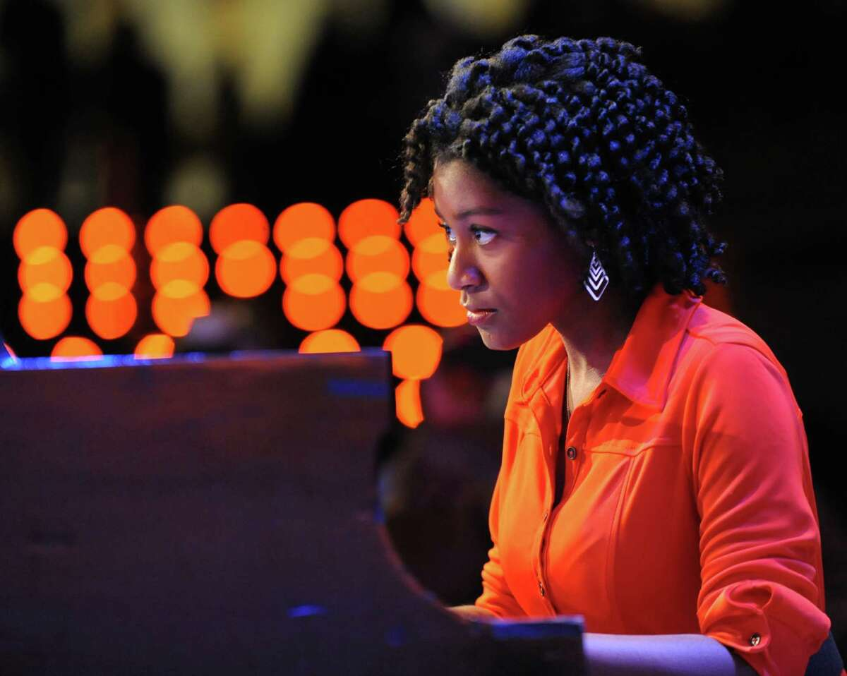 """Amber McKay, a junior at Shaker High School, performs """"Come Sunday,"""" Duke Ellington's Black, Brown Beige Jazz symphony, during the Martin Luther King memorial observance at the Empire State Plaza on Monday, Jan. 20, 2014 in Albany, N.Y. (Lori Van Buren / Times Union"""