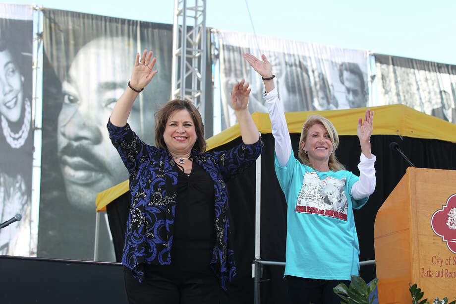 Texas Senators Leticia Van de Putte, D-San Antonio, left, and Wendy Davis, D-Fort Worth, wave to the crowd during the 27th anniversary of the Martin Luther King, Jr. Commemorative March and Program at Pittman-Sullivan Park, Monday, Jan. 20, 2014. Davis is running for governor and Van de Putte is running for lieutenant governor. Photo: JERRY LARA, San Antonio Express-News / © 2014 San Antonio Express-News