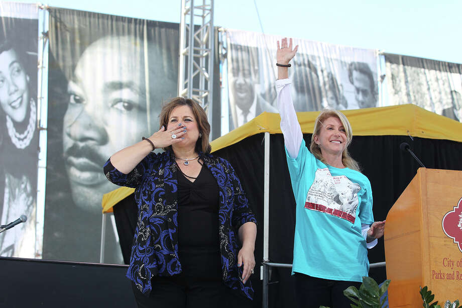 Texas State Senators Leticia Van de Putte, D-San Antonio, left, and Wendy Davis, D-Fort Worth, wave to the crowd during the 27th anniversary of the Martin Luther King, Jr. Commemorative March and Program at Pittman-Sullivan Park, Monday, Jan. 20, 2014. Davis is running for governor and Van de Putte is running for lieutenant governor. Photo: JERRY LARA, San Antonio Express-News / © 2014 San Antonio Express-News
