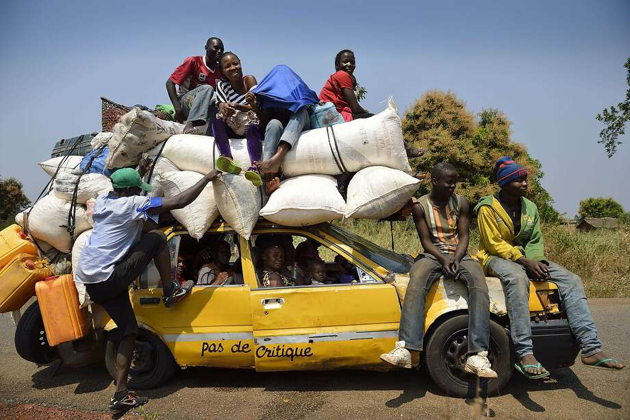 Mind if we share your cab?Bush taxis in Bangui, Central African Republic, can always fit a few more. Photo: Eric Feferberg, AFP/Getty Images
