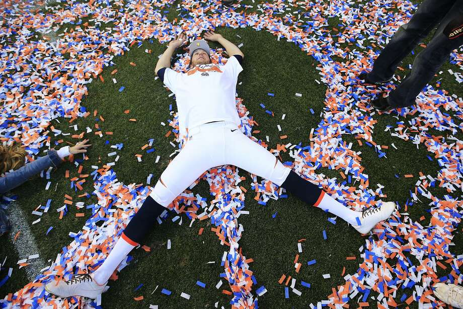 If you're going to the Super Bowl by virtue of winning the AFC Championship like Denver's Britton Colquitt, you get to make confetti angels on the field at Mile High Stadium. Photo: Jamie Squire, Getty Images