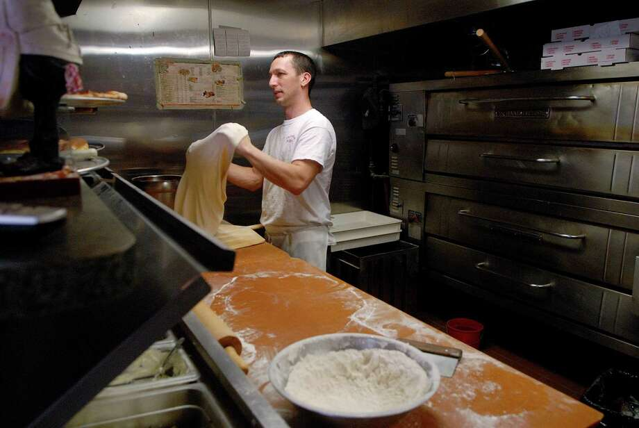 Robert Werbesky prepares the dough for a pizza at Westover Pizza on Stillwater Rd in Stamford, Conn. on Monday January 20, 2013. Photo: Dru Nadler / Stamford Advocate Freelance