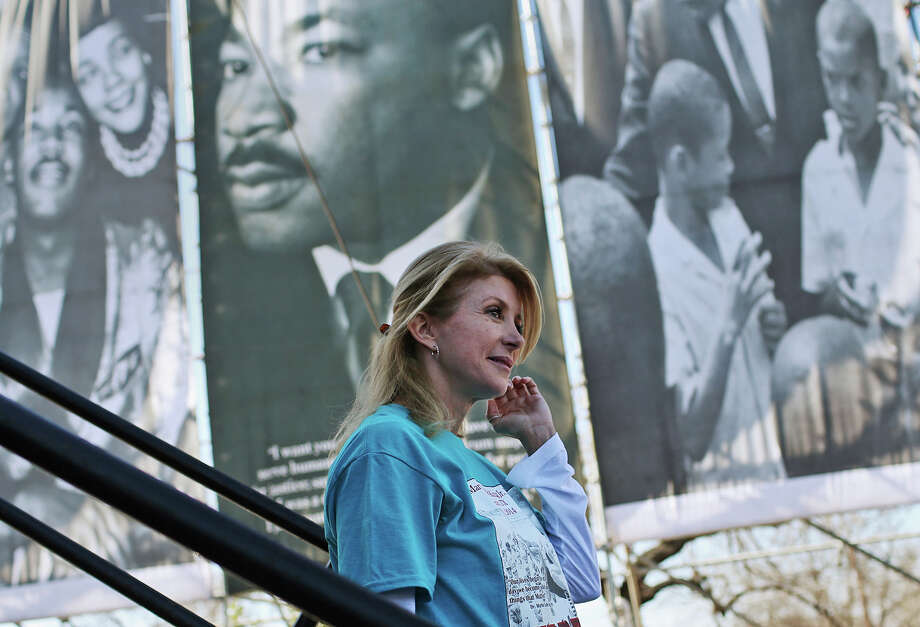 Texas State Senator and gubernatorial candidate Wendy Davis, D-Fort Worth, exits the stage after a short speech at  the 27th anniversary of the Martin Luther King, Jr. Commemorative March and Program at Pittman-Sullivan Park, Monday, Jan. 20, 2014. Photo: JERRY LARA, San Antonio Express-News / © 2014 San Antonio Express-News