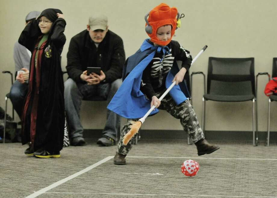Baxter Yauchler, 6, of Ballston Lake takes part in a quidditch game at the Clifton Park-Halfmoon Public Library during a magical world of Hogwarts event based on the Harry Potter books on Monday, Jan. 20, 2014 in Clifton Park, NY.   (Paul Buckowski / Times Union) Photo: Paul Buckowski / 00025417A