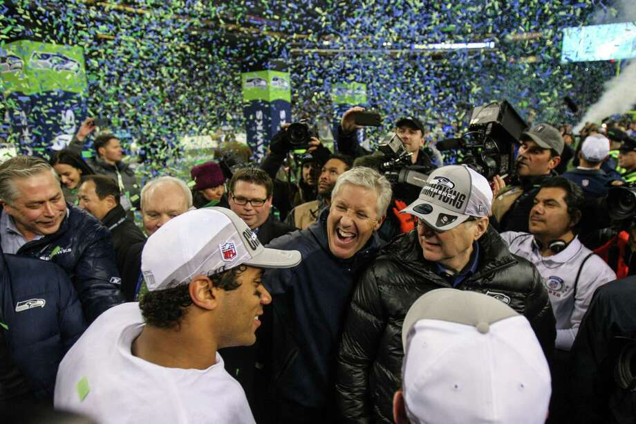 From left, Seattle Seahawks quarterback Russell Wilson, coach Pete Carroll, team owner Paul Allen and general manager John Schneider celebrate after the Seahawks defeated the San Francisco 49ers for the NFC Championship at CenturyLink Field on Sunday, January 19, 2014. Photo: JOSHUA TRUJILLO, SEATTLEPI.COM / SEATTLEPI.COM
