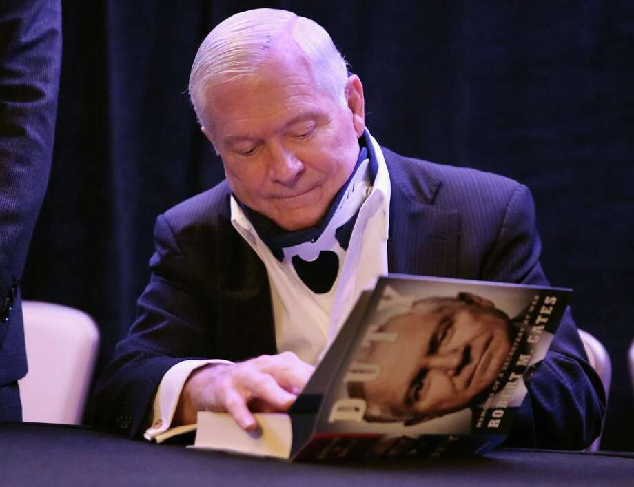 "Former  Secretary of Defense Robert Gates signs copies of his new book, ""Duty."" His disclosure of private conversations in the memoir is troubling. Photo: Chip Somodevilla / Getty Images / 2014 Getty Images"