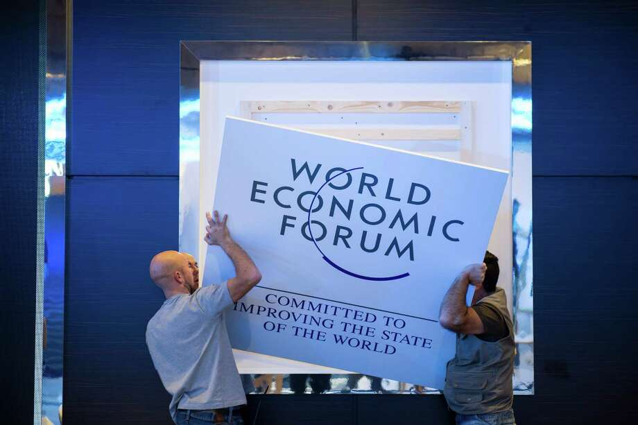 Workers make last preparations inside the Congress Center two days before the opening of the annual meeting of the World Economic Forum, WEF, in Davos, Switzerland, Monday, Jan. 20, 2014. The world's financial and political elite will head this week to the Swiss Alps for 2014's gathering of the World Economic Forum at the ski resort of Davos. (AP Photo/Keystone, Jean-Christophe Bott) Photo: Jean-Christophe Bott, Associated Press / Associated Press contributed