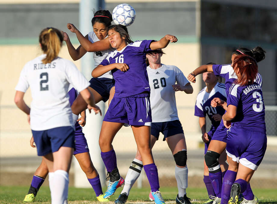 Brackenridge's Chasity Llanas (16) and Roosevelt's Lisette Trujillo try to head the ball during their opening game in the NEISD Girls Varsity Soccer Tournament at Blossom Athletic Center last Thursday. The Eagles play Roosevelt again Friday. Photo: Marvin Pfeiffer / Southside Reporter / Prime Time Newspapers 2014