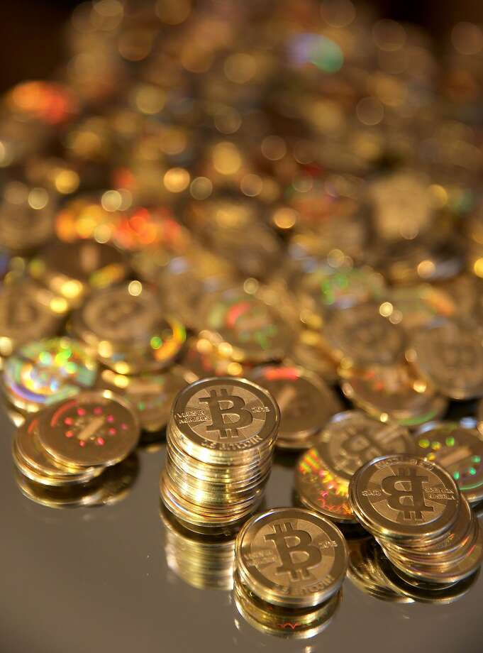 Bitcoins, above, were made just for a photograph in Utah. The virtual currency has had a mixed reception. Photo: George Frey, Bloomberg