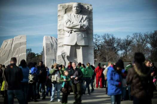 Families gather in front of the Martin Luther King Jr. memorial at the National Mall in Washington, Jan. 20, 2014. Hundreds of people gathered at the memorial Monday in celebration of the King holiday and his legacy. Photo: GABRIELLA DEMCZUK, New York Times / NYTNS