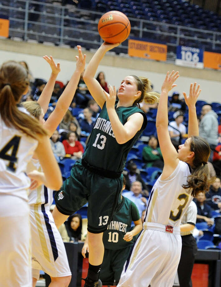 Southwest's Tiffani Rodriguez (13) takes a shot between O'Connor defenders during a UIL 5A girls  playoff basketball game at the UTSA Convocation Center in 2012. Photo: File Photo / San Antonio Express-News / San Antonio Express-News