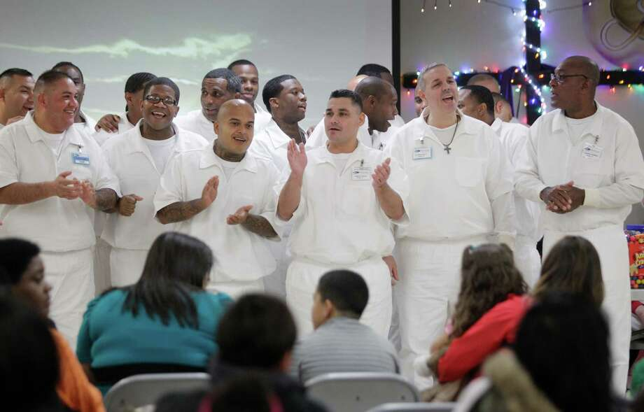 Inmates sing Christmas carols during the Angel Tree event at the Texas Department of Criminal Justice Carol Vance Unit Saturday, Dec. 7, 2013, in Richmond. The inmates are part of InnerChange Freedom Initiative, a faith based pre-release program, at the TDCJ Carol Vance Unit. ( Melissa Phillip / Houston Chronicle ) Photo: Melissa Phillip, Staff / © 2013  Houston Chronicle
