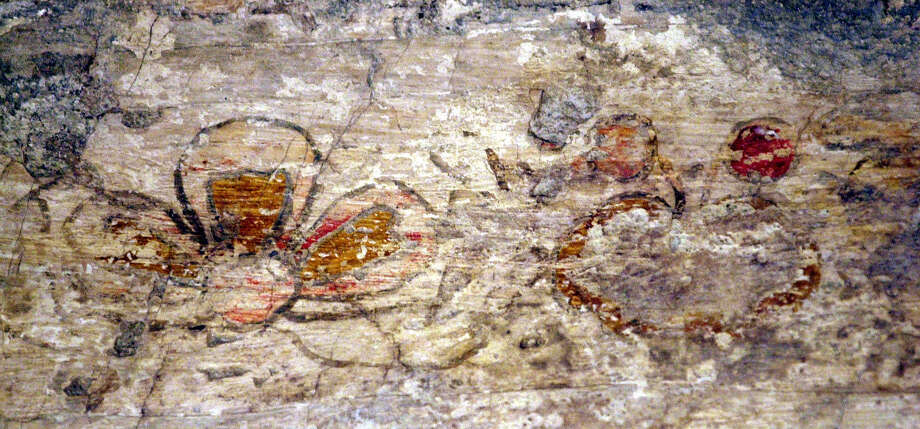 A flower is depicted on the left and what is believed to be a pomegranate is seen on the right in two frescoes discovered 14 years ago on the Alamo's sacristy walls. New research on those faded frescoes is unveiling information about how the room was used in the early stages of the mission's life. Photo: File Photos / San Antonio Express-News / SAN ANTONIO EXPRESS-NEWS