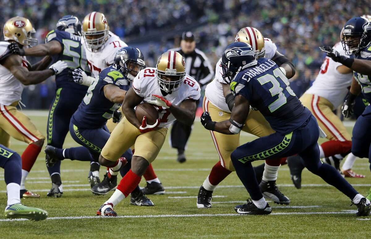 49ers Frank Gore, (21) carries the ball to set up a third quarter score for the 49ers as San Francisco who went on to lose to the Seattle Seahawks 23-17 in the NFC Championship game at CenturyLink Field in Seattle, Washington on Sunday Jan. 19, 2014.
