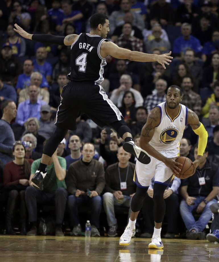 Their 15-3 road record is the NBA's best and the best 18-game road start in franchise history. Among the 15 wins: An unlikely victory over the Warriors at Oracle Arena with the Big Three sitting out for rest.PHOTO: The Golden State Warriors' Andre Iguodala (right) looks to pass away from the Spurs' Danny Green (4) during the first half on Dec. 19, 2013, in Oakland, Calif. Photo: Ben Margot, Associated Press