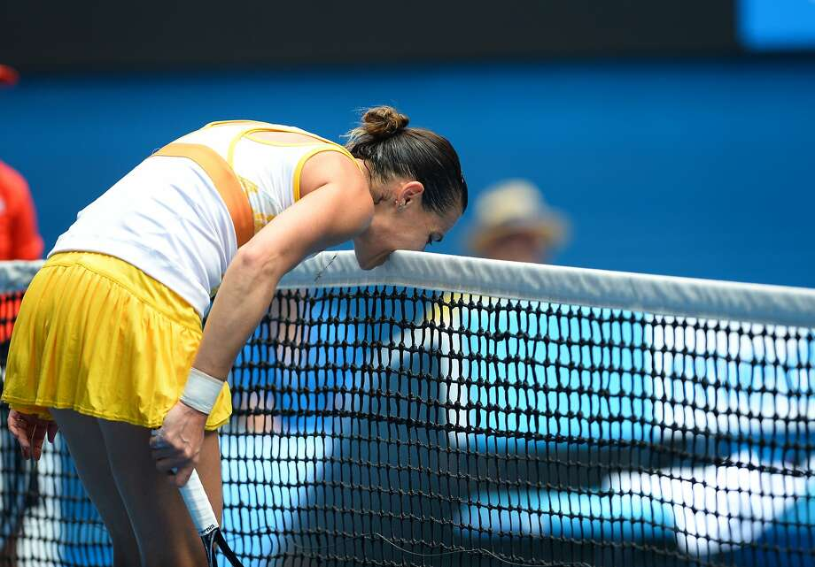 Please do not chew the court, Ms. Pennetta: Italy's Flavia Pennetta bites the net after losing a point during her 