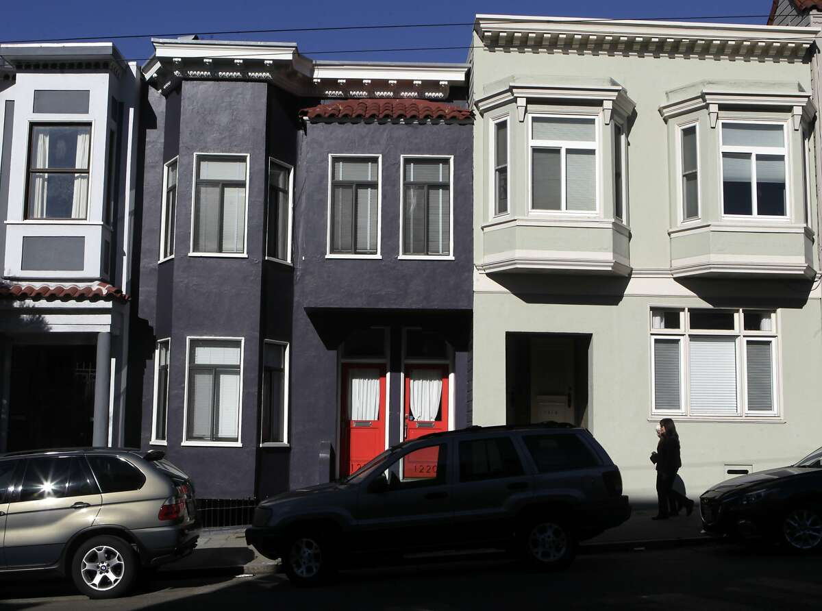 A duplex is painted black on Union Street in San Francisco, Calif. on Tuesday, Jan. 14, 2014. Painting or covering buildings in dark gray or black is becoming very trendy throughout the city.
