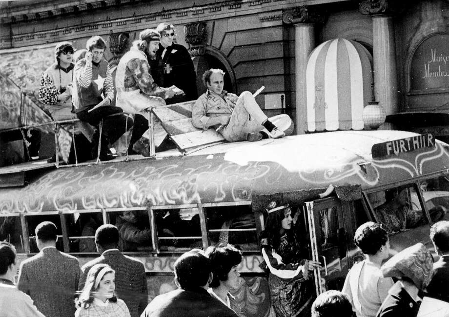 Ken Kesey rides atop the bus Further on April 26, 1967, while holding a flute in San Francisco. Photo: Joe Rosenthal, STAFF