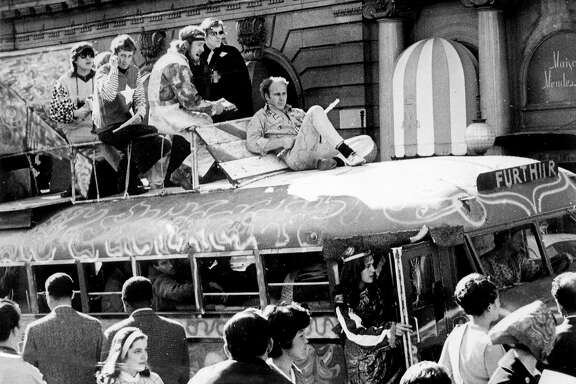 KESEY/26APR67/MN/JR - Ken Kesey, on top of the Furthur Bus, holding a flute in San Francisco.  Photo by Joe Rosenthal. Also ran 11/30/03  ALSO Ran on: 01-15-2006 Ken Kesey, holding a flute, rode on top of &quo;Furthur&quo; with some of the Merry Pranksters in 1967 during a rollicking trip to San Francisco from his home in La Honda.