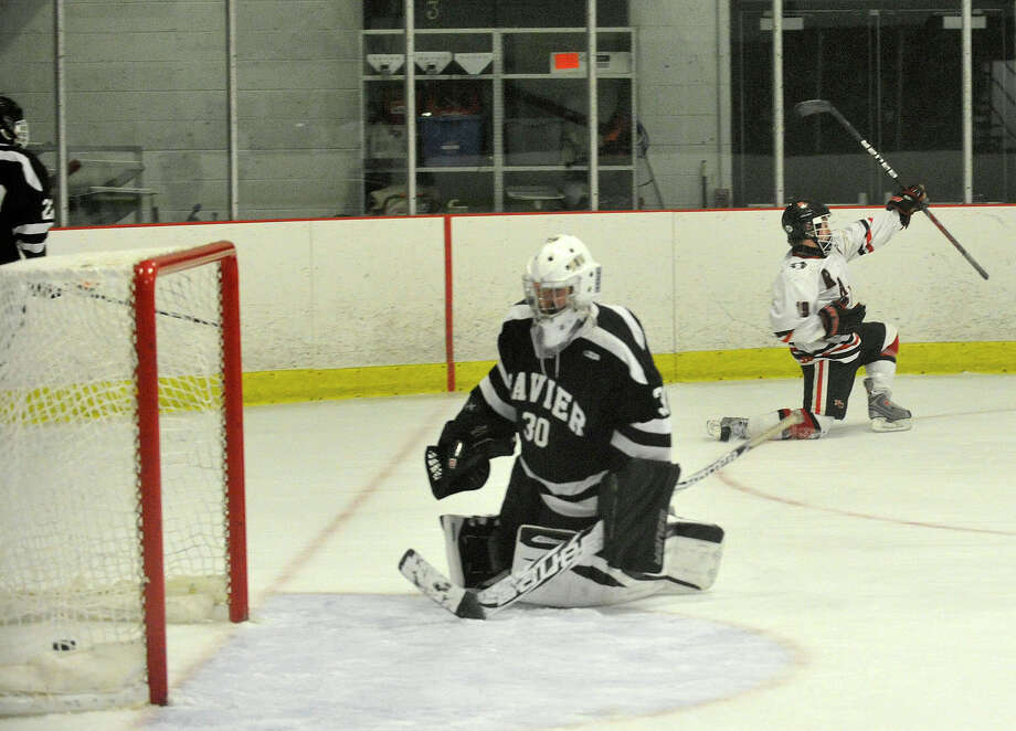 New Canaan's Harry Stanton pumps his fist after scoring on Xavier goalie Ben Guidobono during their hockey game at Darien Ice Rink in Darien, Conn., on Monday, Jan. 20, 2014. New Canaan won, 5-2. Photo: Jason Rearick / Stamford Advocate