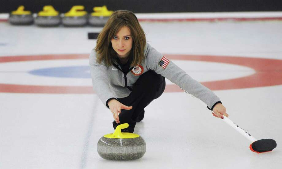 Two-time Olympian Jessica Schultz, who was born and raised in Anchorage, Alaska, delivers a rock at the Anchorage Curling Club on Sunday, Dec. 22, 2013, in Anchorage, Alaska.  Schultz will compete in the curling competition during the 2014 Olympic Winter Games in Sochi, Russia. (AP Photo/Anchorage Daily News, Bill Roth) LOCAL TV OUT (KTUU-TV, KTVA-TV) LOCAL PRINT OUT (THE ANCHORAGE PRESS, THE ALASKA DISPATCH) ORG XMIT: AKAND301 Photo: Bill Roth / Anchorage Daily News