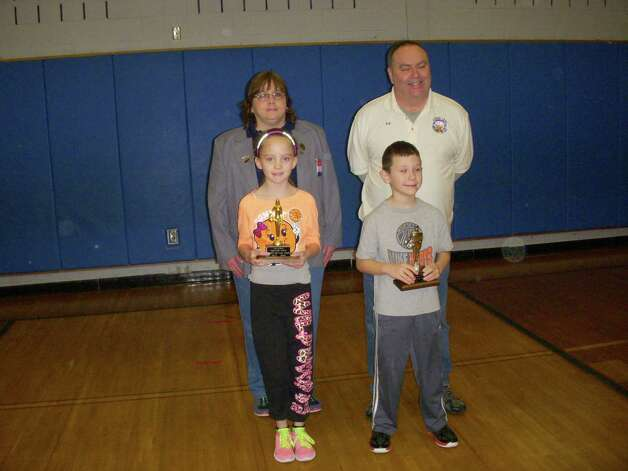 Alexis Marie Cornwell won first place for girls ages 8 and 9 in the Elks Hoop Shoot presented on Jan. 11 at the Watervliet Elementary School gym. Aiden Diaz won second place for the boys. Both are from Heatly School in Green Island. Alexis will now advance to the regionals at Glen Falls High School on Feb. 9. Here they stand with Donna Bauer from the Colonie lodge and Edward Rice from the Watervliet lodge. (Submitted photo)