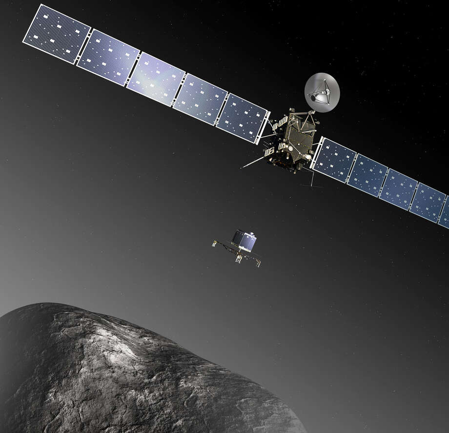 An artist's rendition shows the Rosetta dropping its Philae lander onto comet 67P. The actual drop is set for November. Photo: European Space Agency / Associated Press / ESA medialab
