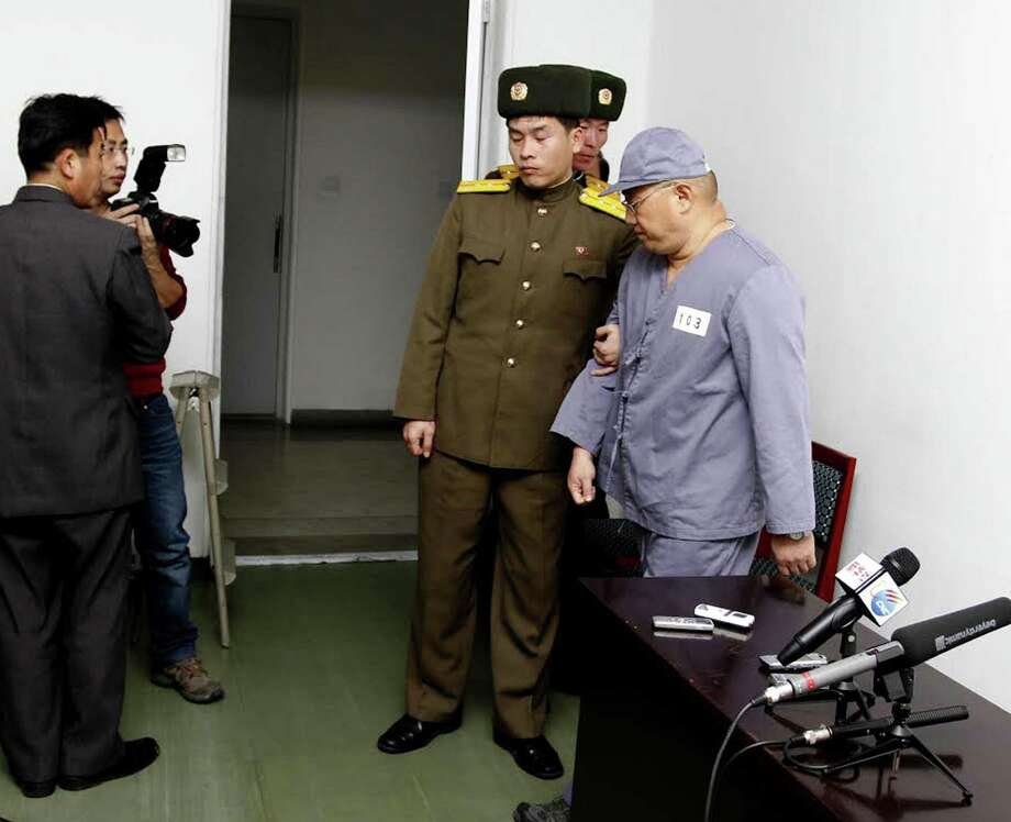 American missionary Kenneth Bae (right) leaves after speaking to reporters at Pyongyang Friendship Hospital. Photo: Kim Kwang Hyon / Associated Press / AP