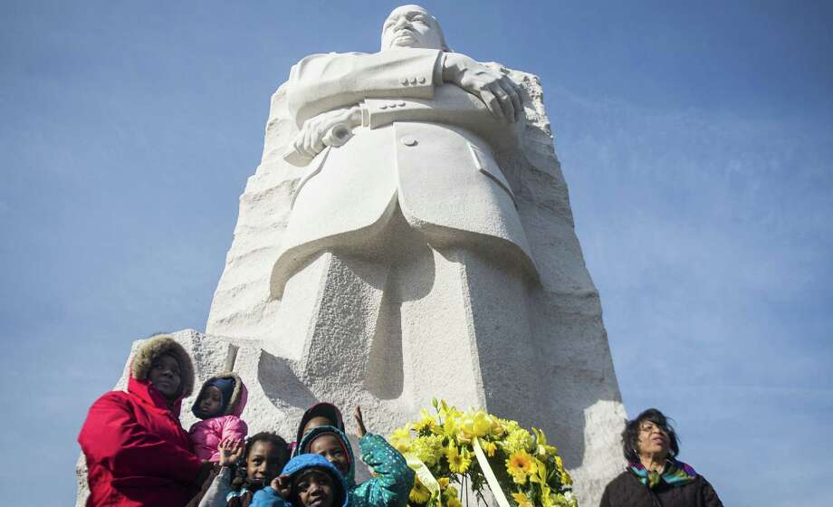 Families pose for pictures in front of the Martin Luther King Jr. Memorial in Washington, D.C. Hundreds of people gathered at the memorial in celebration of the King holiday. Photo: Gabriella Demczuk / New York Times / NYTNS