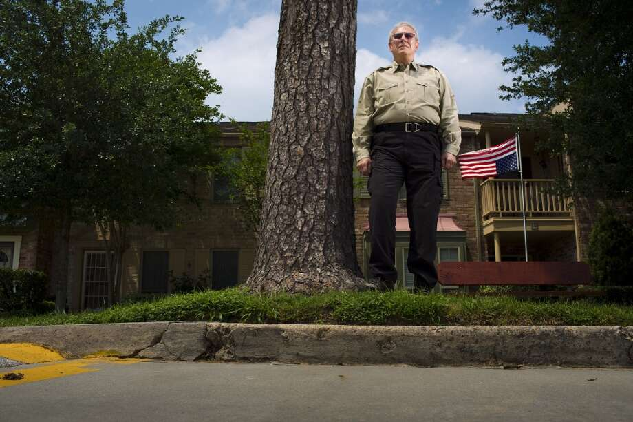 Billy Martin poses in front of his townhouse on May 17, 2013 in Houston. Photo: Eric Kayne, For The Chronicle