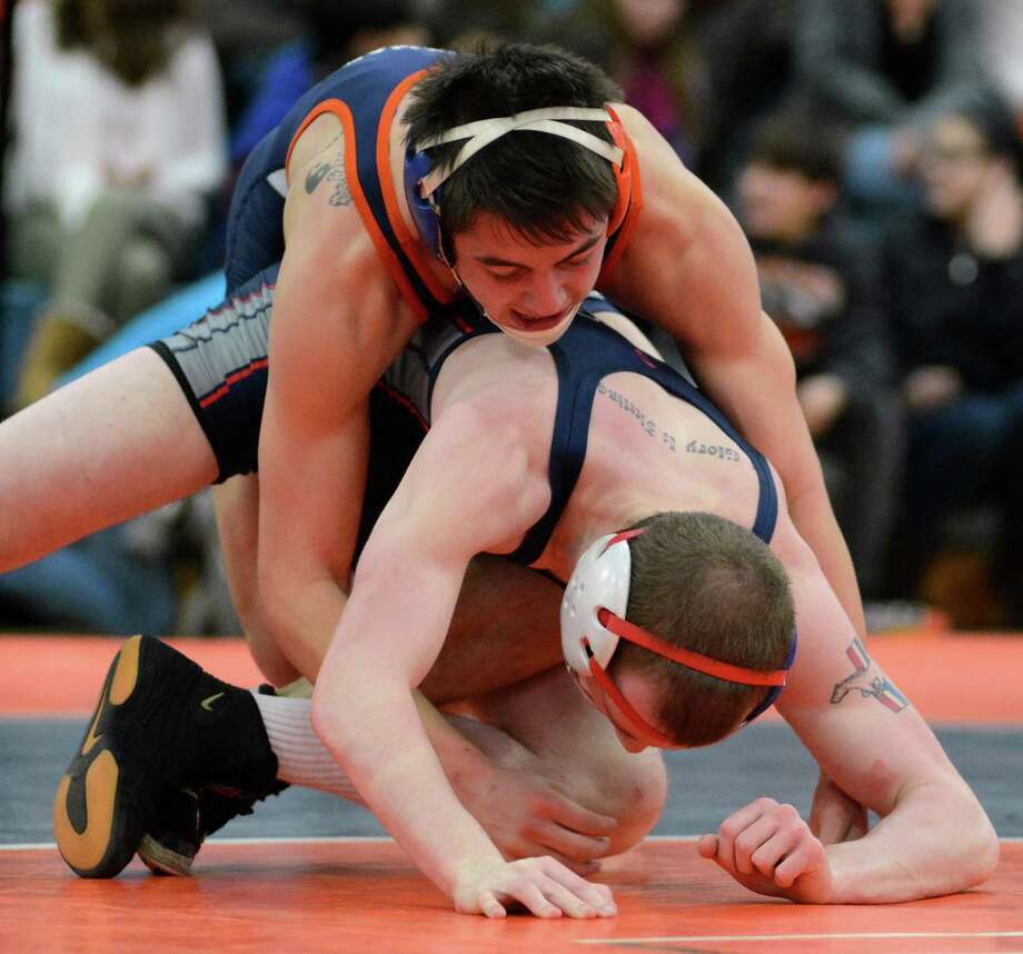 Danbury High Schools Steven Beckham wrestles against Mount Anthonys Bailey Willard in the 138 lb weight class at Danbury on Monday Jan. 20, 2014. Photo: Lisa Weir / The News-Times Freelance