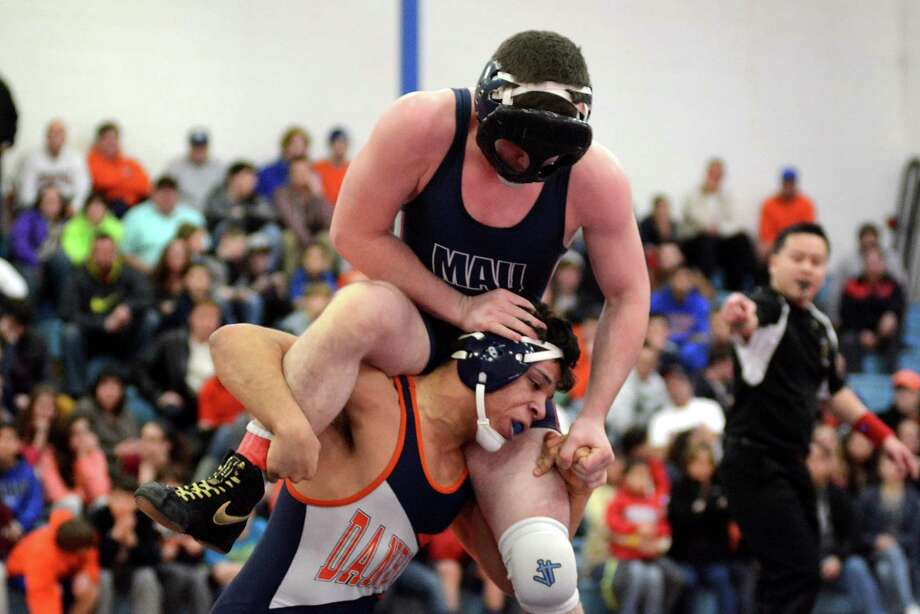 Danbury High Schools John Garcia wrestles against Mount Anthonys Austin Price in the 182 lb weight class at Danbury on Monday Jan. 20, 2014. Photo: Lisa Weir / The News-Times Freelance