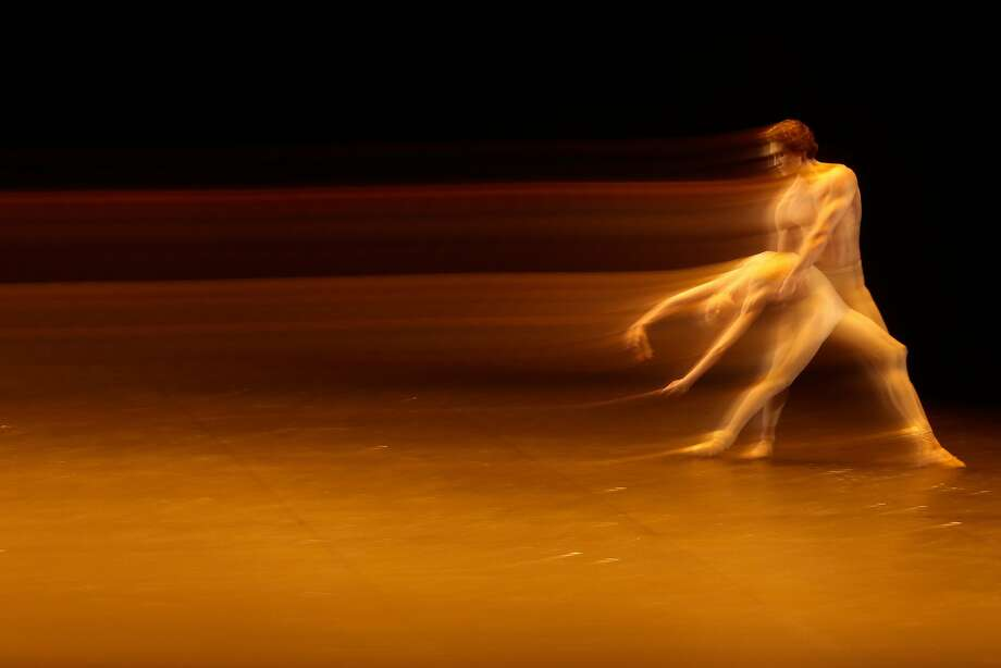"In this photo taken with a long shutter speed ballet dancers Lucia Lacarra, left and Marion Dino perform during the press rehearsal of the ballet gala "" Malakhov & Friends - The Final"" of the Berlin State Ballet at the German Opera in Berlin, Monday, Jan. 20, 2014. The program marks the 10th anniversary of the ballet company and is also the last season for Vladimir Malakhov, the artistic director at Berlin State Ballet since 2004. (AP Photo/Markus Schreiber) Photo: Markus Schreiber, Associated Press"