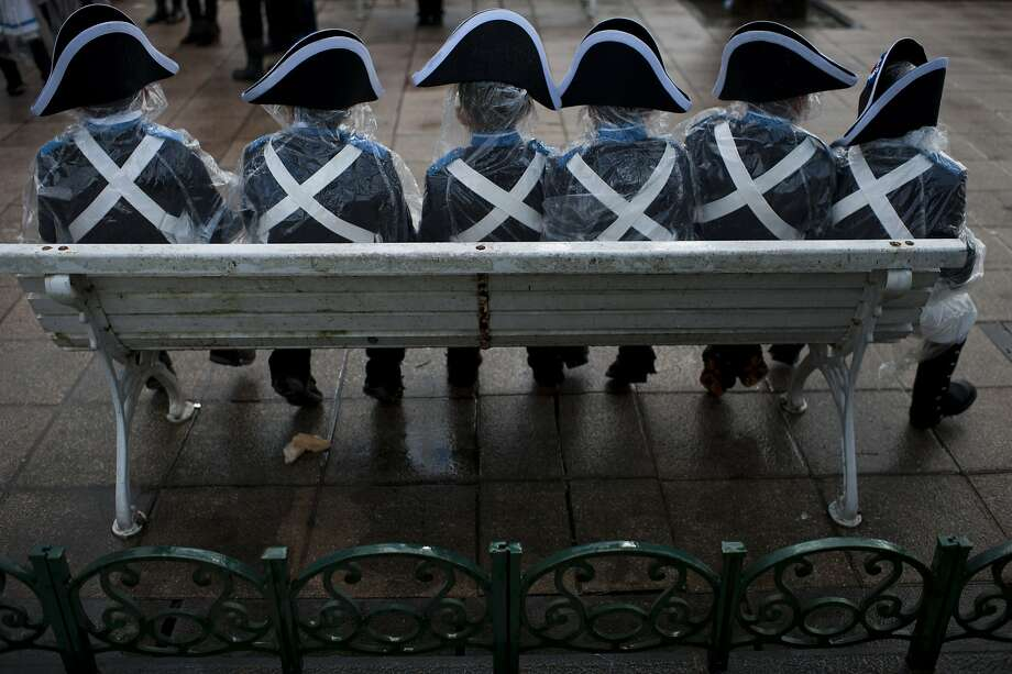 Tamborilleros'' wearing their uniforms, rest on a bench,  in the traditional ' La Tamborrada', during 'El Dia Grande', the main day of San Sebastian feasts, in the Basque city of San Sebastian, northern Spain, Monday, Jan. 20, 2014. From midnight to midnight companies of perfectly uniformed marchers parade through the streets of San Sebastian playing drums and barrels in honor of their patron saint. (AP Photo/Alvaro Barrientos) Photo: Alvaro Barrientos, Associated Press