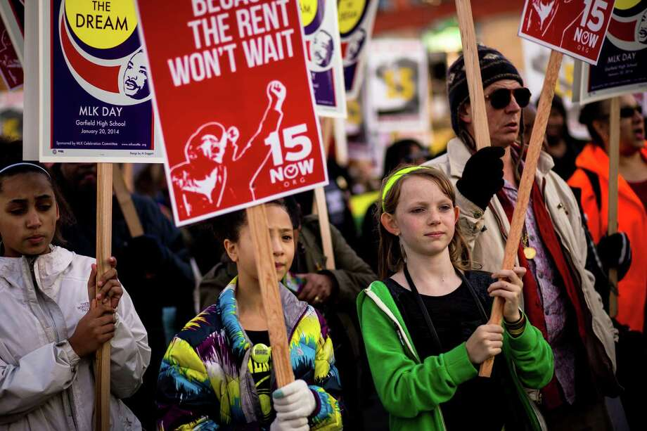 Young girls walk together during the 32nd ÒRise Up!  Restore the Dream!Ó annual celebration for Martin Luther King, Jr., on Monday, Jan. 20, 2014, in Seattle. A mass of hundreds walked from Garfield High School to Westlake Park. The event also included a rally and a workshop. Photo: JORDAN STEAD, SEATTLEPI.COM / SEATTLEPI.COM