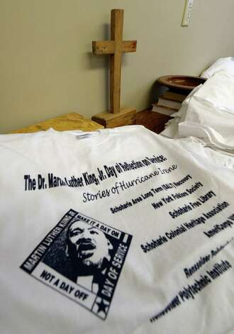 Tee shirts to be distributed to attendees sit on a table near the gathering Monday afternoon Jan. 20, 2014 in Middleburgh, N.Y.  as part of the Dr. Martin Luther King, Jr. Day of Reflection on Service: Stories of Hurricane Irene program.        (Skip Dickstein / Times Union) Photo: SKIP DICKSTEIN / 0025433A