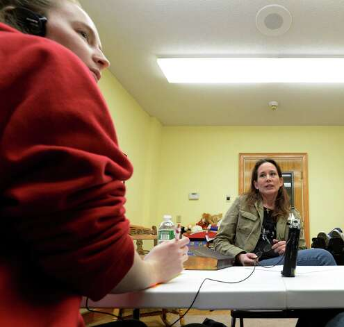 Wendy Adams reflects on her experience with hurricane Irene by reading a prepared statement to RPI student volunteer Katie Grabowski, left,  Monday afternoon Jan. 20, 2014 in Middleburgh, N.Y.  as part of the Dr. Martin Luther King, Jr. Day of Reflection on Service: Stories of Hurricane Irene program.        (Skip Dickstein / Times Union) Photo: SKIP DICKSTEIN / 0025433A