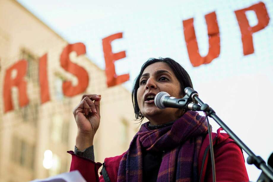 Seattle City Council member Kshama Sawant addresses the masses in Westlake Park following the 32nd ÒRise Up!  Restore the Dream!Ó annual celebration for Martin Luther King, Jr., on Monday, Jan. 20, 2014, in Seattle. A mass of hundreds walked from Garfield High School to Westlake Park. The event also included a rally and a workshop. Photo: JORDAN STEAD, SEATTLEPI.COM / SEATTLEPI.COM