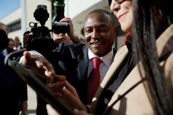 Exonerated death row inmate Anthony Graves uses a tablet computer to file a grievance against former Burleson County District Attorney Charles Sebesta on Monday at Texas Southern University.