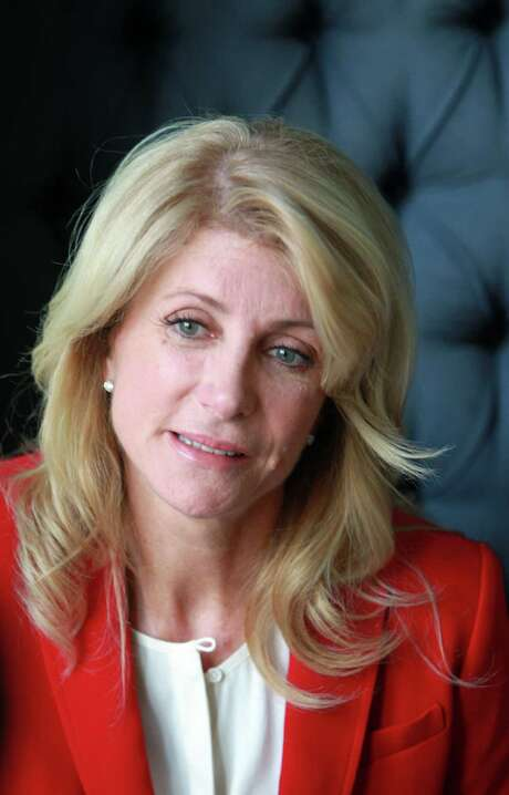 "Texas Sen. Wendy Davis was on the offensive Monday. ""I came from a place of struggle, and we can parse dates all day long,"" she said of questions raised by Attorney General Greg Abbott. Photo: Mayra Beltran, Staff / © 2013 Houston Chronicle"