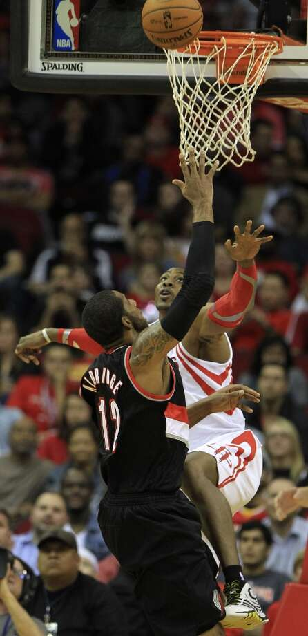 Rockets center Dwight Howard contests a shot against LaMarcus Aldridge of the Blazers. Photo: Karen Warren, Houston Chronicle
