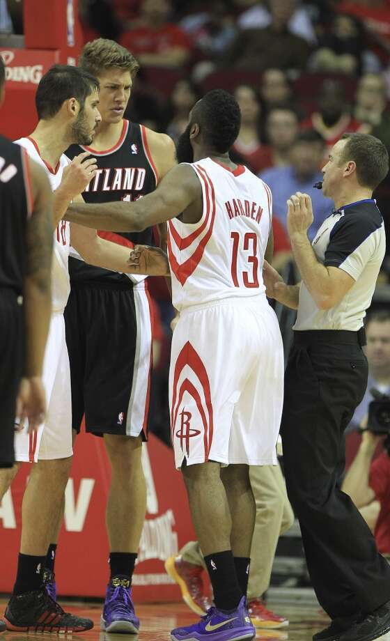 Rockets shooting guard James Harden confronts Meyers Leonard of the Trail Blazers after a hard foul. Photo: Karen Warren, Houston Chronicle