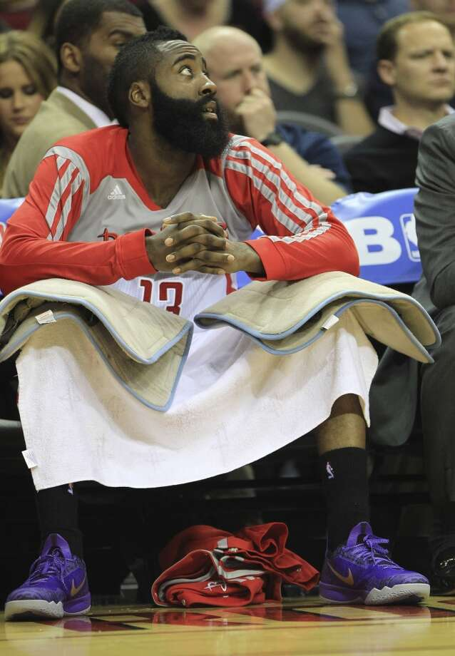 Rockets shooting guard James Harden sports a pair of purple shoes against the Trail Blazers. Photo: Karen Warren, Houston Chronicle