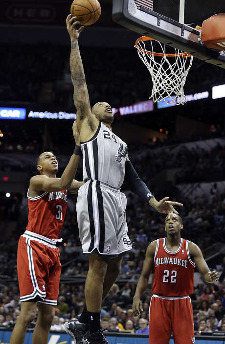Malcolm Thomas scored only two points, but he grabbed nine rebounds and blocked two shots in 15 minutes Sunday. Photo: Edward A. Ornelas / San Antonio Express-News / © 2014 San Antonio Express-News