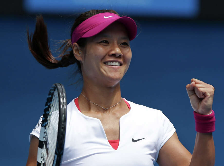 Li Na of China celebrates after defeating Flavia Pennetta of Italy during their quarterfinal at the Australian Open tennis championship in Melbourne, Australia, Tuesday, Jan. 21, 2014. (AP Photo/Aaron Favila) ORG XMIT: XMEL156 Photo: Aaron Favila / AP